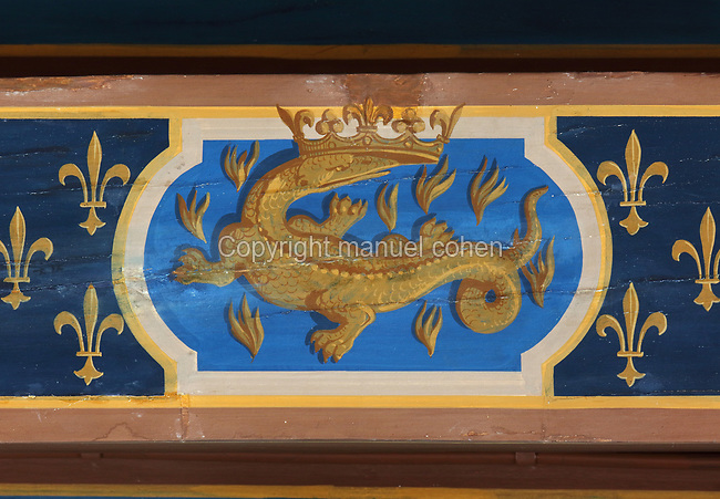 Crowned salamander, symbol of Francois I, painted detail on the roof beams of the Salle du Roi, or King's Hall, used by Francois I for meals and audiences, on the first floor of the Francois I wing, built early 16th century in Italian Renaissance style, at the Chateau Royal de Blois, built 13th - 17th century in Blois in the Loire Valley, Loir-et-Cher, Centre, France. The hand-painted wallpaper, tiled floor and painted ceiling, were restored by Felix Duban in 1861-66. The chateau has 564 rooms and 75 staircases and is listed as a historic monument and UNESCO World Heritage Site. Picture by Manuel Cohen