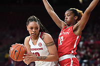 NWA Democrat-Gazette/J.T. WAMPLER Arkansas' Kiara Williams drives to the basket while Houston's Alyssa Okoene defends Thursday March 21, 2019 at Bud Walton Arena in Fayetteville during the first round of the Women's National Invitational Tournament.