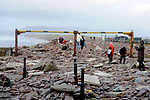 GLENBEIGH IRELAND JANUARY 7TH 2014: : Photo shows the devastation at Rossbeigh Beach in County Kerry after the violent storms of the past few days. Photo shgows the main roadway covered in rubble and debris blocking access to the famous beach.<br /> Picture by Don MacMonagle