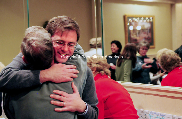 BRISTOL, CT, 06 NOV 12-11062AJ01- Sen. Jason C. Welch, R-Bristol, hugs Jim Boone, his father-in-law while celebrating his second win to the 31st Senate District on Tuesday.  Alec Johnson/ Republican-American