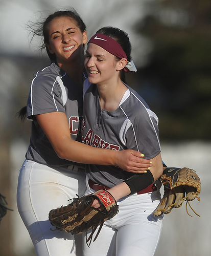 Lizzy Belfiore #19, Clarke pitcher, left, and centerfielder #5 Sonia Iacoboni celebrate after their team's 4-2 win over Division Avenue in a Nassau County Conference ABC-II varsity softball game at Clarke High School on Thursday, April 26, 2018.