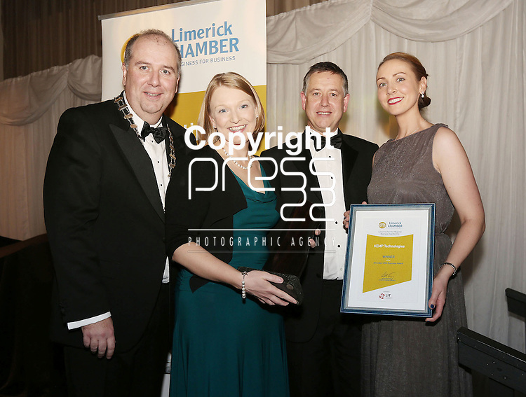 21/11/2014  WITH COMPLIMENTS.   Attending the Chamber Presidents Dinner and the Limerick Chamber Regional Business Awards 2014 in the Strand Hotel were Cathal Treacy, Limerick Chamber President and Kieran Martin, Bank of Ireland(Best SME Business Award Sponsor)  present  the Best SME Business Award to Marguerite O'Grady  General Manager and Deirdre Sarsfield Kemp Technologies.  Picture Liam Burke/Press 22