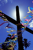 Itaparica Island, Bahia State, Brazil; cross decorated for Candomble and Roman Catholic syncretic festival.