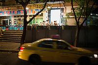 Patrons eat at a hotpot restaurant on Tiyu Road in Chongqing, China.