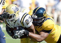 Deandre Coleman of California tackles Johnathan Franklin of UCLA during the game at Memorial Stadium in Berkeley, California on October 9th, 2010.   California defeated UCLA, 35-7.