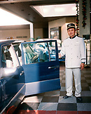 CHINA, Macau, Asia, Grand Lapa Hotel, the bellhop holding a car door open