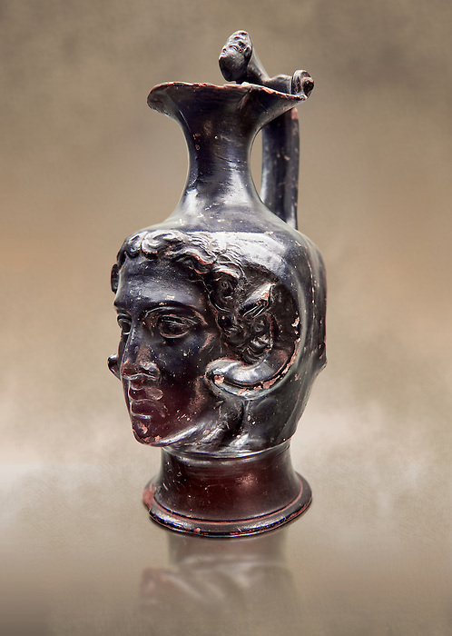 Etruscan bucchero jug with a face,  National Archaeological Museum Florence, Italy