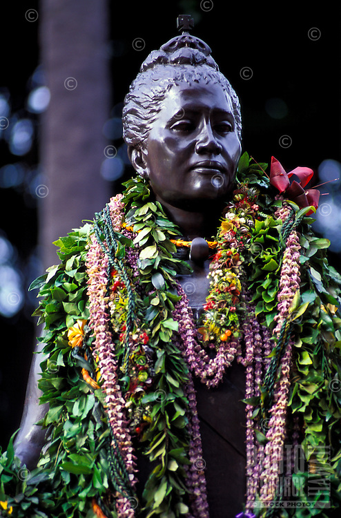 Statue of Queen Liliuokalani with flower leis taken at the 100th anniversary onipaa observance of the Hawaiian monarchy overthrow at Iolani palace