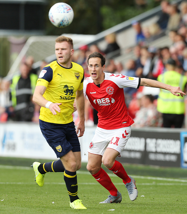 Fleetwood Town's Josh Morris vies for possession with Oxford United's Chris Cadden<br /> <br /> Photographer Rich Linley/CameraSport<br /> <br /> The EFL Sky Bet League One - Fleetwood Town v Oxford United - Saturday 7th September 2019 - Highbury Stadium - Fleetwood<br /> <br /> World Copyright © 2019 CameraSport. All rights reserved. 43 Linden Ave. Countesthorpe. Leicester. England. LE8 5PG - Tel: +44 (0) 116 277 4147 - admin@camerasport.com - www.camerasport.com