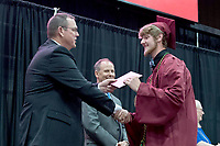 Bud Sullins/Special to the Herald-Leader<br /> Siloam Springs School Board member Brent Butler congratulates Tristan Moose.