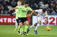 (L-R) Enda Stevens of Sheffield United challenges Kyle Naughton of Swansea City during the Sky Bet Championship match between Swansea City and Sheffield United at the Liberty Stadium, Swansea, Wales, UK. Saturday 19 January 2019