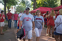 NWA Democrat-Gazette/CHARLIE KAIJO Jerry and Tina Turner of Olive Branch, Miss. (from center left) walk through the Ole Miss tailgate before a football game, Saturday, September 7, 2019 at Vaught-Hemingway Stadium in Oxford, Miss.