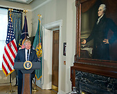 United States President Donald J. Trump makes remarks next to a portrait of Alexander Hamilton, the first US Secretary of the Treasury, prior to signing Executive Orders concerning financial services at the Department of the Treasury in Washington, DC on April 21, 2017.<br /> Credit: Ron Sachs / Pool via CNP