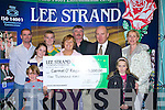 CHEQUE IT OUT: Carmel O'Regan, Tralee, collects her cheque for EUR5,000 from Jerry Dwyer, production manager with Lee Strand, Ballymullen, on Friday. Pictured with Carmel are Mary, Martin and Roisin O'Regan with Katie, Greg, Conor and David Horan.   Copyright Kerry's Eye 2008