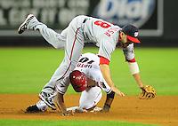 Jun. 2, 2011; Phoenix, AZ, USA; Washington Nationals second baseman Danny Espinosa leaps over Arizona Diamondbacks base runner Justin Upton after forcing him out in the fourth inning at Chase Field. Mandatory Credit: Mark J. Rebilas-