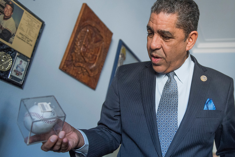 UNITED STATES - MARCH 09: Rep. Adriano Espaillat, D-N.Y., talks about his baseball memorabilia in his Longworth office, March 9, 2017., March 9, 2017. (Photo By Tom Williams/CQ Roll Call)