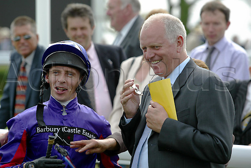 27 July 2004: TED DURCAN and MICK CHANNON jockey and trainer of the winner of The Betfair Molecomb Stakes, TOURNEDOS at Goodwood Photo: Glyn Kirk/Action Plus...horse racing 040727 flat trainers