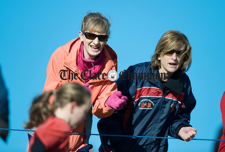 Hilda O Connor and Aisling Power encourage athletes in the girls U-9 race at the Patrick O'Dea cross country and road races at Lissycasey. Photograph by John Kelly.