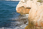 Cave and wave cut notch in cliff on the coast at La Cala del Moral, Malaga, Spain