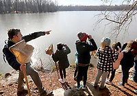 Sim Barrow, environmental science coordinator for Fayetteville Public Schools, points out birds Monday, January 13, 2020, during a nature scavenger hunt on the Environmental Study Center Trail at the Lake Fayetteville Environmental Study Center in Springdale. The students in Rebecca Wilbern's class from Vandergiff Elementary School in Fayetteville, spent half of the day learning inside center and the second half on the nature hike.Check out nwaonline.com/200114Daily/ and nwadg.com/photos for today's photo gallery.<br /> (NWA Democrat-Gazette/David Gottschalk)