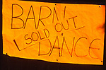 AT5BTD Orange paper sign with handwritten message saying Barn Dance Sold Out