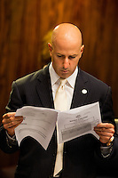TALLAHASSEE, FLA. 5/3/13-SESSIONEND050313CH-Sen. Jospeh Abruzzo, D-Royal Palm Beach, scans the calendar for a bill important to him during the final day of the regularly scheduled legislative session, May 3, 2013 at the Capitol in Tallahassee...COLIN HACKLEY PHOTO