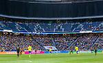 Solna 2014-06-01 Fotboll Landskamp , Sverige - Belgien :  <br /> Vy &ouml;ver planen under matchen mot l&auml;ktare med publik p&aring; nedersta sektionen, tom sektion i mitten och &ouml;vre etage &ouml;vert&auml;ckt<br /> (Photo: Kenta J&ouml;nsson) Keywords:  Sweden Sverige Friends Arena Belgium Belgien inomhus interi&ouml;r interior supporter fans publik supporters