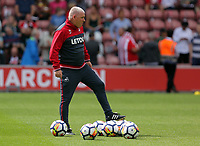 Swansea City assistant manager, Nigel Gibbs observes the players warm up prior to the Premier League match between Southampton and Swansea City at the St Mary's Stadium, Southampton, England, UK. Saturday 12 August 2017