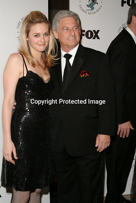 Alicia Silverstone &amp; Haim Saban<br />The H.E.L.P. Group&rsquo;s Teddy Bear Ball, honoring Sandy Grushow and his wife Barbara<br />Beverly Hilton Hotel<br />Beverly Hills, CA, USA  <br />Saturday, December 6, 2003  <br />Photo By Celebrityvibe.com/Photovibe.com