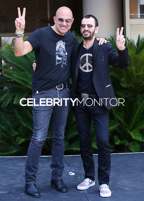 HOLLYWOOD, LOS ANGELES, CA, USA - JULY 07: John Varvatos, Ringo Starr at the announcement of special collaboration of John Varvatos and Ringo Starr on occasion of Ringo's birthday at Capitol Records Studio on July 7, 2014 in Hollywood, Los Angeles, California, United States. (Photo by Xavier Collin/Celebrity Monitor)