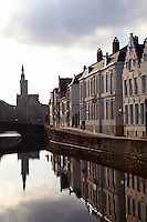 BRUGES, BELGIUM - FEBRUARY 06 : A general view of the typical residential houses along a canal with bridge on February 06, 2009 in Bruges, West Flanders, Belgium. The powerful light of winter creates a halo on the church and the bright facades of the houses, some with the typical stepped gable roofs.(Photo by Manuel Cohen)
