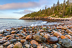Acadia National Park, Maine: Rounded boulders, rocks and surf at dawn, Hunters Beach