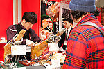 FOODEX JAPAN 2015, March 4, 2015, Chiba, Japan : An exhibitor offers samples of cured ham during the 40th International Food and Beverage Exhibition (FOODEX JAPAN 2015) in Makuhari Messe International Convention Complex. About 2,800 exhibitors from 83 nations participate in the Asian's largest food and beverage trade show. This year organizers expect 75,000 visitors for the four day event, which runs from March 3rd to 6th. (Photo by Rodrigo Reyes Marin/AFLO)