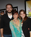 """Opening Night after party - As the World Turns' Colleen Zenk poses with her kids Dylan Pinter and Kelsey Crouch Pinter as she stars in """"Marrying George Clooney: Confessions from a Midlife Crisis"""" on March 1, 2012 at Cap21 America's Musical Theatre Conservatory & Theatre Company, New York City, New York.  (Photo by Sue Coflin/Max Photos)"""