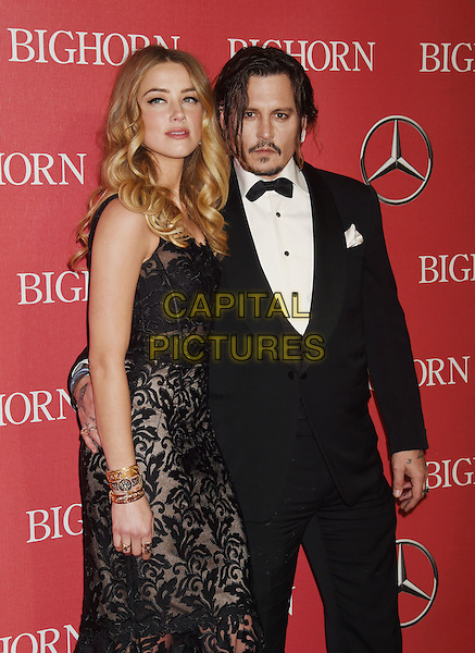 PALM SPRINGS, CA - JANUARY 02: Actress Amber Heard and actor Johnny Depp attend the 27th Annual Palm Springs International Film Festival Awards Gala at Palm Springs Convention Center on January 2, 2016 in Palm Springs, California.<br /> CAP/ROT/TM<br /> &copy;TM/ROT/Capital Pictures