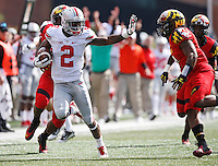 Ohio State Buckeyes running back Dontre Wilson (2) gives a stiff arm to Maryland Terrapins defensive back William Likely (4) during the first quarter of the NCAA football game at Byrd Stadium in College Park, Maryland on Oct. 4, 2014. (Adam Cairns / The Columbus Dispatch)
