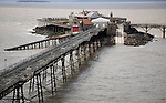 Birnbeck Pier in the Bristol Channel at Weston super Mare, Somerset, England with Flat Holm island in the distance