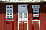 Red barn doors and vents with 1873 sign.