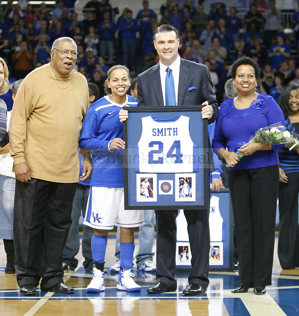 UK Hoops Head Coach Matthew Mitchell presents senior point guard Amber Smith a framed jersey during the first half of UK Hoops senior night game vs. South Carolina at Memorial Coliseum in Lexington, Ky., on Thursday, Feb. 23, 2012. Photo by Tessa Lighty | Staff