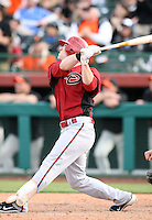 Collin Cowgill #70 of the Arizona Diamondbacks bats against the San Francisco Giants in the first spring training game of the season at Scottsdale Stadium on February 25, 2011  in Scottsdale, Arizona. .Photo by:  Bill Mitchell/Four Seam Images.
