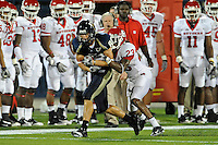 11 September 2010:  FIU wide receiver Greg Ellingson (82) attempts to break away from Rutgers cornerback Brandon Bing (23) in the first quarter as the Rutgers Scarlet Knights defeated the FIU Golden Panthers, 19-14, at FIU Stadium in Miami, Florida.