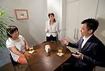 """Keiko"" (l) undertakes a class simulating a first date with her unidentified coach at Infini, a school training marriage hopefuls how to hook Mr. or Mrs. Right in Tokyo, Japan on Sep. 9, 2010. At center, school head Etsuko Satake critiques the session."