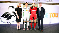 Pictured: Katy Hosford (RED) and Alicia Powe (WHITE) of the Swansea City FC Ladies' team model the home and away kits with Dsability Sport Wales and Shelter Cymru representatives. Monday 19 June 2017<br />