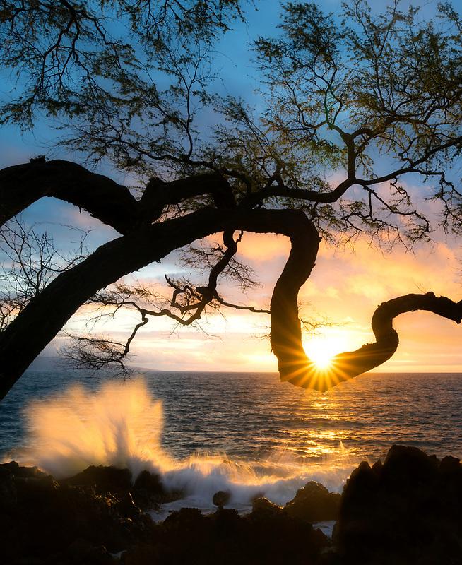 Sunset with sunburst and waves. Wailea Maui.