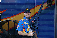 May 11, 2013; Commerce, GA, USA: NHRA funny car driver Ron Capps holds an umbrella during a rain delay to the Southern Nationals at Atlanta Dragway. Mandatory Credit: Mark J. Rebilas-