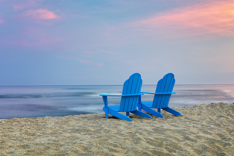 Two Adirondack chairs on beach. Hawaii, The Big Island