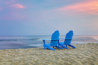 Two Adirondack chairs on beach. Hawaii, The Big Island