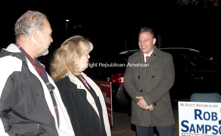 WOLCOTT- NOVEMBER 042014 110414DA01- Republican State Rep. Rob Sampson (R-80) greets, Roselyn Goldman, center, and her husband Joe, left, as he campaigns as voters arrive at Tyrrell School in Wolcott oin Tuesday. <br /> Darlene Douty Republican American