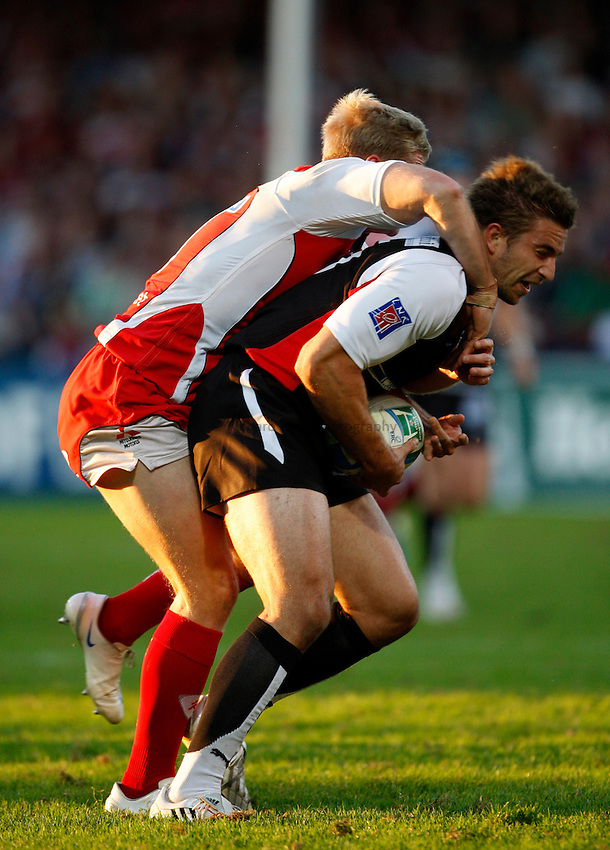 Photo: Richard Lane/Richard Lane Photography. Gloucester Rugby v Biarittz. Heineken Cup. 11/10/2008. Biarittz' Benjamin Thierry is tackled by Gloucester's Ian Balshaw.