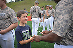 Jonah Brisson, 8, of Chugiak, thanks Chinook player Jeremy Johnson for autographing a baseball following the final game of the season.  Photo for the Star by  Michael Dinneen